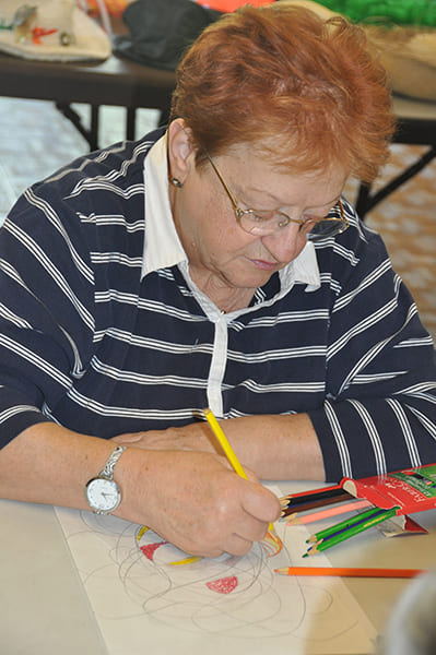 Rose Centers participant drawing a colored pencil sketch
