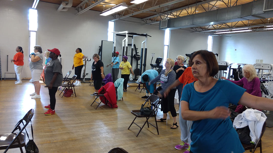 Rose Centers participants engaged in a group fitness class at a workout facility