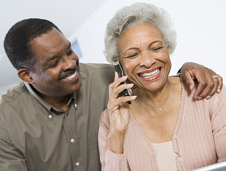 BRI Care Consultation- A man with his arm around the shoulder of a woman on the phone